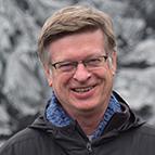 Head shot of Tom Gardner, President of the Society of Alumni.